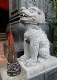 Qilin asian mythological marble statue. Qilin asian mythological statue in the yard. Chinese and vietnam ancient mythological magic creature. a mythical hooved stock photo