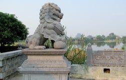 Qilin asian mythological marble statue. Qilin asian mythological statue in the yard. Chinese and vietnam ancient mythological magic creature. a mythical hooved stock image