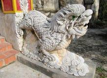 Qilin asian mythological marble statue. Qilin asian mythological statue in the yard. Chinese and vietnam ancient mythological magic creature. a mythical hooved royalty free stock photography