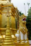 Qilin asian mythological statue in Thailand buddhist temple. Qilin asian mythological animal guard statue in Thai Buddhist temple entrance, Thailand royalty free stock photography