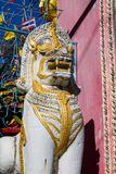 Qilin asian mythological statue in Thailand buddhist temple. Qilin asian mythological animal guard statue in Thai Buddhist temple entrance, Thailand royalty free stock image