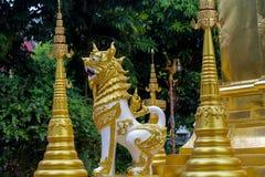 Qilin asian mythological statue in Thailand wat. Qilin asian mythological statue in the yard of Thailand wat thai buddhist temple near big stupa. Ancient Royalty Free Stock Image