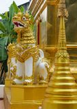Qilin asian mythological guard statue in Thailand wat. Qilin asian mythological statue in the yard of Thailand wat thai buddhist temple near big stupa. Ancient Royalty Free Stock Photos