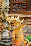 Qilin asian mythological wooden statue in Thailand wat. Qilin asian mythological statue in the yard of Thailand wat thai buddhist temple near big stupa. Ancient Royalty Free Stock Photography