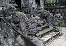 Qilins asian mythological stone statue. Qilin asian mythological statue in the yard an the entrance to the stairs pagoda. Chinese and vietnam ancient royalty free stock photography