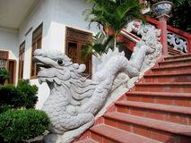 Qilins asian mythological stone statue. Qilin asian mythological statue in the yard an the entrance to the stairs pagoda. Chinese and vietnam ancient stock photos