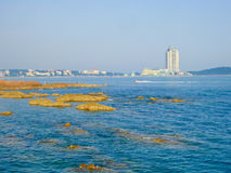 Qingdao city office buildings. Qingdao city urban office buildings crossing beach in Shandong province China Stock Photo