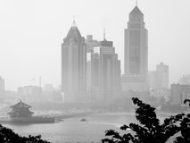 Qingdao city office buildings. Qingdao city urban office buildings foggy view in Shandong province China Stock Images