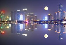 Qingdao skyline China. Qingdao cityscape night scene, full moon, reflection royalty free stock photography