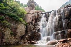 Qingdao laoshan chaoyin sault landscape in China. The tourists in China Qingdao laoshan scenic spot the cascades Stock Photo