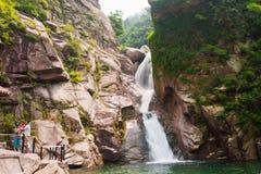Qingdao laoshan chaoyin sault landscape in China. The tourists in China Qingdao laoshan scenic spot the cascades,On July 27, 2014 Stock Photo