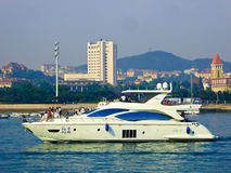 Qingdao sea sightseeing boats. Tourists taking yacht boating on Qingdao sea in Shandong province China Royalty Free Stock Photo