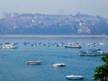 Qingdao sea sightseeing boats. Tourists taking yacht boating on Qingdao sea in Shandong province China Stock Photography