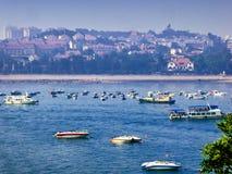 Qingdao sea sightseeing boats. Tourists taking yacht boating on Qingdao sea in Shandong province China Stock Image