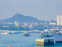 Qingdao sightseeing boats on the sea. Qingdao pleasure-boats and speedboats on the sea with island background in Shandong province China Royalty Free Stock Photo