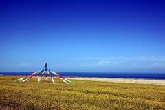 Qinghai Lake scenery. Tibetan prayer flags at lakeshore of Qinghai Lake, China Royalty Free Stock Photography