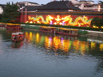 Qinhuai River - dragon and boats. Boats set off down the Qinhuai River in Nanjing, with the lantern dragon in the background stock photo