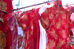Qipao, cheongsam,  or Chinese National dress sell on the street Royalty Free Stock Photos