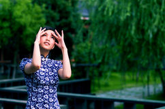 Qipao woman looking at the sky Royalty Free Stock Photography