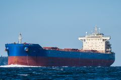 Bulk Carrier en route to Seattle. QM/V Quest Trade inbound on Puget Sound en route to Seattle Royalty Free Stock Photo