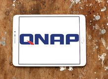 QNAP Systems company logo. Logo of QNAP Systems company on samsung tablet on wooden background. QNAP is a Taiwanese corporation that specializes in providing Stock Photos
