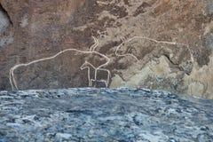 QOBUSTAN Prehistorical petroglyphs rock-painting in Azerbaijan Stock Images