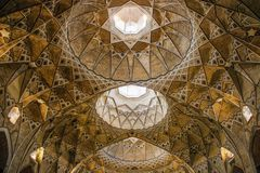 Details of the decorations of the magnificent Iranian Persian Mosque Fatima Masumeh Shrine in gold colour stock images