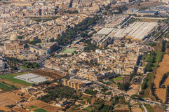Qormi in Malta. City Qormi in Malta island behind window of aircraft Stock Photos