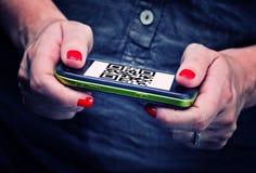 Qr code on smartphone Stock Photos