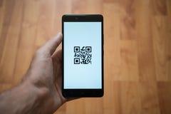 QR code on smartphone screen Stock Photo