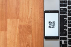 QR Code on smartphone screen Royalty Free Stock Photo