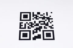 Qr code on a white background on paper. Qr code on a white background stock images