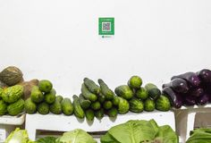 Qr codes for cashless payment stands over a street vegetable booth. Qr codes for cashless payment with smart phones stands over a street vegetable booth in China royalty free stock photo