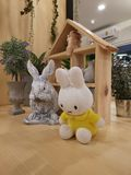 Cute Rabbit dolll and wooden house stock photos
