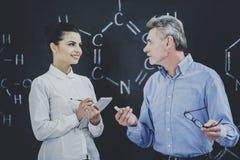 Química de profesor Consultates Student About foto de archivo libre de regalías