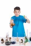 Químico joven, fondo de la educación: Adolescente divertido Imagen de archivo libre de regalías
