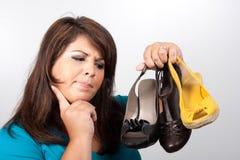 Qué zapatos yo desgastan Foto de archivo