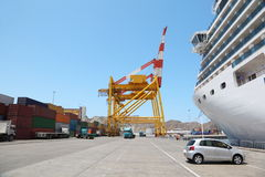 Quaboos port: big cruise ship in port, cargos Royalty Free Stock Photos