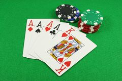 Quad Aces. On a green baize Stock Photography