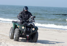 Quad on a beach (ATV) royalty free stock photography