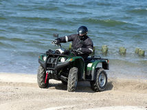 Quad on a beach (ATV) Royalty Free Stock Image
