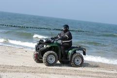 Quad on a beach (ATV) stock photography