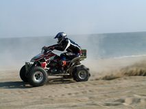 Quad bike. On a beach with sea background Stock Images