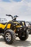 Quad bike. Yellow quad bike on beach Stock Photos