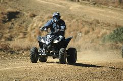 Quad Bike. R on a dirt road Royalty Free Stock Image