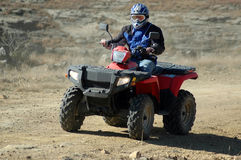 Quad Bike. R on dirt road stock photography