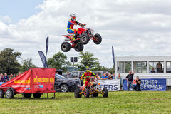 Quad bike airborne. The Kangaroo Kid airborne after jumping from a ramp on his quad bike at the Hanbury Countryside Show in Worcestershire Stock Image