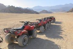 Quad bike, ATV. Quad bikes moto safari in the desert in Egypt Royalty Free Stock Image