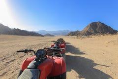 Quad bike, ATV. Quad bikes moto safari in the desert in Egypt Royalty Free Stock Photos