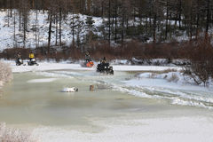 Quad bike ATV and snowmobiles  on the river in South Yakutia, Russia Stock Image